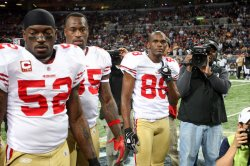 The 49ers captains participate in the coin toss in St. Louis