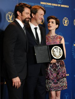 Tom Hooper appears backstage with cast members Hugh Jackman and Anne Hathaway at 65th annual DGA Awards in Los Angeles