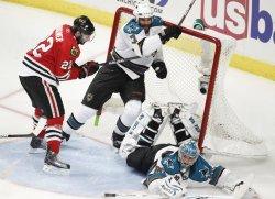 Sharks Nabokov, Wallin and Blackhawks Brouwer crash into net in Chicago