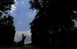 Jason Day hits a tee shot on the 5th hole at the PGA