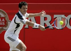 HENMAN PLAYS BACKHAND