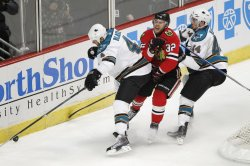 Sharks Blake and Vlasic hit Blackhawks Versteeg in Chicago
