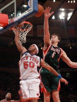 Milwaukee Bucks Andrew Bogut (6) blocks the shot of New York Knicks Eddie House at Madison Square Garden