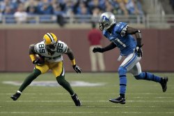 Green Bay Packers James Jones catches the ball for a first down in front of Detroit Lions Eric Wright in Detroit