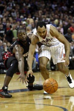 Miami Heat guard Dwyane Wade and Charlotte Bobcats guard Gerald Henderson