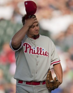 Phillies Pitcher Blanton Reacts Against the Rockies in Denver