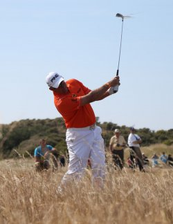 Lee Westwood hits out of the rough at the Open Championship