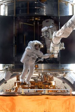 STS-125 Astronaut's conduct the third mission spacewalk to continue work on Hubble