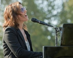 Sarah McLachlan sings request songs for reporters during Voices in the Park benefit concert sound check
