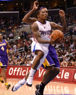 Los Angeles Clippers Eric Bledsoe drives by Los Angeles Lakers' Jordan Hill in Los Angeles
