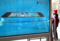 Apple's new iPhone 5C is promoted on the streets of Beijing