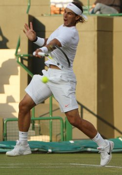 Nadal plays a forehand at the Wimbledon Championships