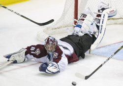 Avalanche Goalie Anderson Dives for Save Against the Bruins in Denver....Flags Fly at Half-Staff Day after Assassination Attempt Against U.S. Rep Giffords in Florence, Arizona