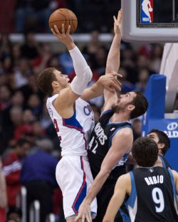Los Angeles Clippers Blake Griffin shoots over Minnesota Timberwolves Kevin Love