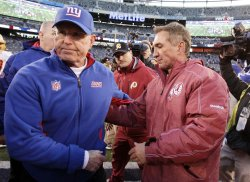 New York Giants head coach Tom Coughlin and Washington Redskins head coach Mike Shanahan at MetLife Stadium in New Jersey