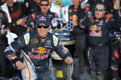 Kahne exits car after winning the Kobalt Tools 500 in Arizona.