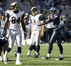 Seattle Seahawks' cornerback Kelly Jennings (R) signals that St. Louis Rams field goal attempt by Josh Brown (C) was wide left in the first quarter at Qwest Field in Seattle on September 22, 2009. The Seahawks beat the Rams 28-0.