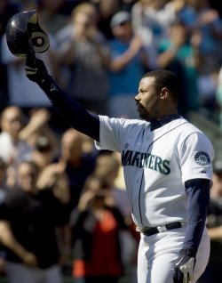 Seattle Mariners' Ken Griffey Jr. tips his hat after hitting a three run RBI homer.