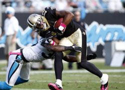 New Orleans Saints wide receiver Marques Colston fights for yards as he is tackled by Carolina Panthers strong safety Charles Godfrey
