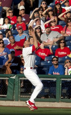 Philadelphia Phillies Chase Utley catches a fly ball near first at Citizens Bank Park