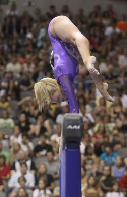 Gymnast Redecca Bross competes in the Visa Championship in Dallas