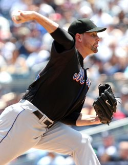 New York Mets starting pitcher Mike Pelfrey throws a pitch at Yankee Stadium in New York