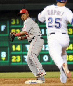 Angels Aybar turns a double play against the Rangers