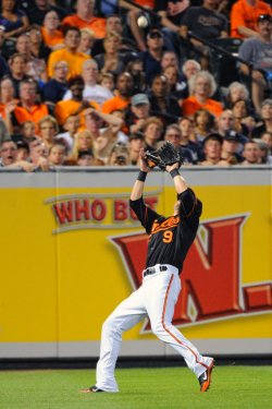 Nate McLouth catches a fly ball in Baltimore, MD