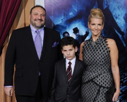"Joel Silver and Karyn Fields and son Max attend the ""Sherlock Holmes: A Game of Shadows"" premiere in Los Angeles"