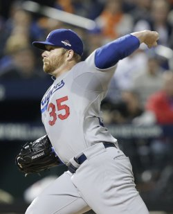 Dodgers starting pitcher Brett Anderson throws a pitch