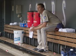 Padres Pitcher Correia Sits Alone in Dugout in Denver