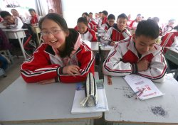 Tibetan students attend class at a new middle school in Ganzi Prefecture