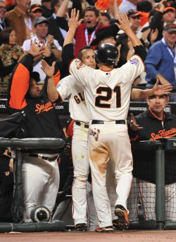 Giants' Freddy Sanchez scores during game 1 of the World Series in San Francisco