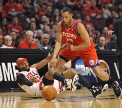 Bulls' Hamilton and 76ers' Turner go for ball during Playoff in Chicago
