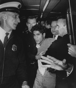 Sirhan Sirhan is led away after shooting Senator Robert F. Kennedy
