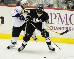 Penguins Neal Plays Blocks Tampa Bay's St Louis From Puck in Pittsburgh