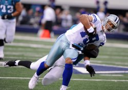 Dallas Cowboys Miles Austin gets wrapped up by a Jacksonville Jaguars defender