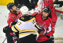 Capitals Matt Hendricks pulls at Boston Bruins' Milan Lucic in Washington