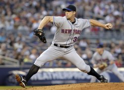 New York Mets starting pitcher Chris Capuano throws a pitch at Yankee Stadium in New York