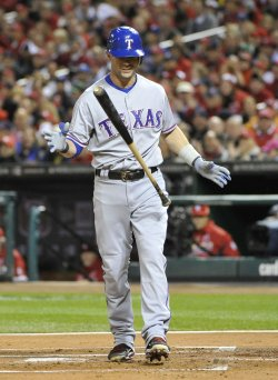 Rangers Michael Young reacts after striking out during game 6 of the World Series in St. Louis