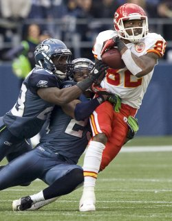 Kansas City Chiefs wide receiver Dwayne Bowe is brought down after catching a short pass in Seattle.