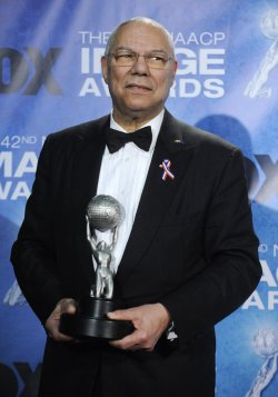 Colin Powell poses backstage with his award at the 42nd NAACP Image Awards Awards in Los Angeles