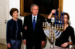 PRESIDENT BUSH AND FIRST LADY PARTICIPATE IN HANUKKAH CELEBRATION