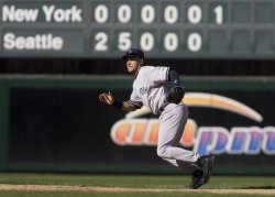 New York Yankees' shortstop Derek Jeter goes after a ground ball.
