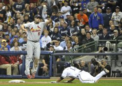 Brewers Jerry Hairston, Jr. slides safely into first during game 6 of NLCS in Milwaukee, Wisconsin