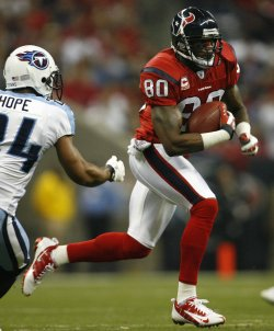 Houston Texans Andre Johnson Runs for a Gain After Making a Catch as Tennessee Titans Chris Hope at Reliant Stadium in Houston