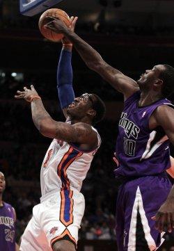 Sacramento Kings Samuel Dalembert blocks the shot of New York Knicks Amar'e Stoudemire at Madison Square Garden in New York