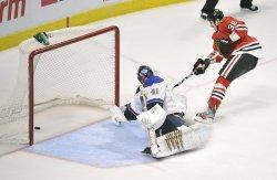 Blackhawks' Bolland Scores on Blues' Halak in Chicago