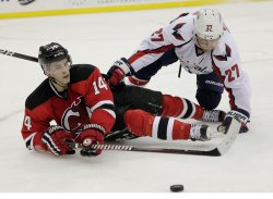 New Jersey Devils Adam Henrique and Washington Capitals Karl Alzner dive for a lose puck at the Prudential Center in New Jersey
