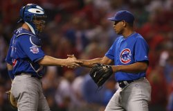Chicago Cubs Derrek Lee chases foul ball